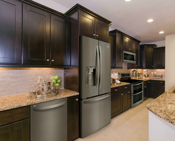 Dark kitchen cabinets with stainless appliances for Chocolate kitchen cabinets with stainless steel appliances